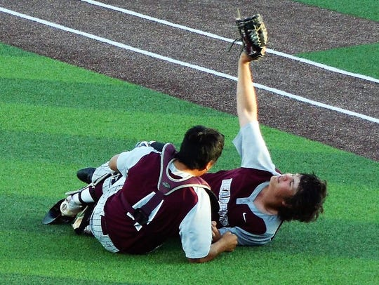 De Leon first baseman Jake Sanders shows the umpires his catch after colliding with catcher Joey Garcia when the two went after an infield popup during last season's regional quarterfinal playoff game against Hawley at ACU's Crutcher Scott Field.