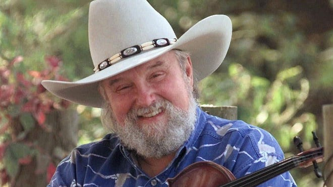 Charlie Daniels is shown near his Lebanon, Tenn., home in this Aug. 23, 1998, file photo. The Country Music Hall of Famer and Grand Ole Opry member died on Sunday.