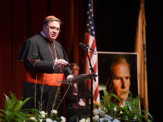 Cardinal Joseph Tobin speaks during a memorial service