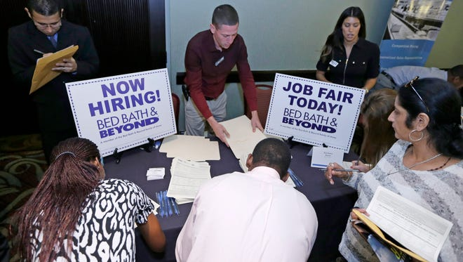 At a job fair in Miami Lakes, Fla.