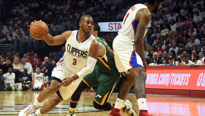 Los Angeles Clippers guard Chris Paul (3) moves the ball as center DeAndre Jordan (6) provides the screen against Utah Jazz guard George Hill (3) during the first half in game five of the first round of the 2017 NBA Playoffs at Staples Center.