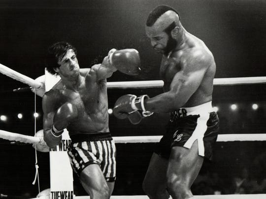 """Rocky (Sylvester Stallone) throws a punishing left at Clubber Lang (Mr. T) in their title fight in """"Rocky III."""""""