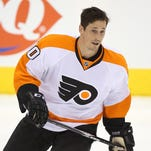 Vinny Lecavalier hasn't played since Nov. 12. He missed Tuesday's morning skate with tightness in his back.