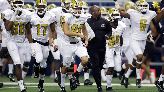 Alabama State head coach Brian Jenkins, center, runs on to the field with his team prior to an NCAA college football game against UTSA, Saturday, Sept. 3, 2016, in San Antonio. (AP Photo/Eric Gay)