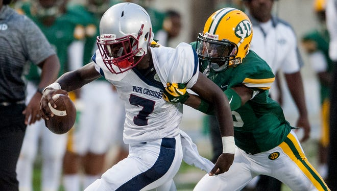 Jeff Davis' Marques Gibson stops Park Crossing's Micale Cunningham at ASU Stadium in Montgomery, Ala., on Thursday August 18, 2016.