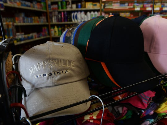 A Mappsville, Virginia hat sits on a shelf near the
