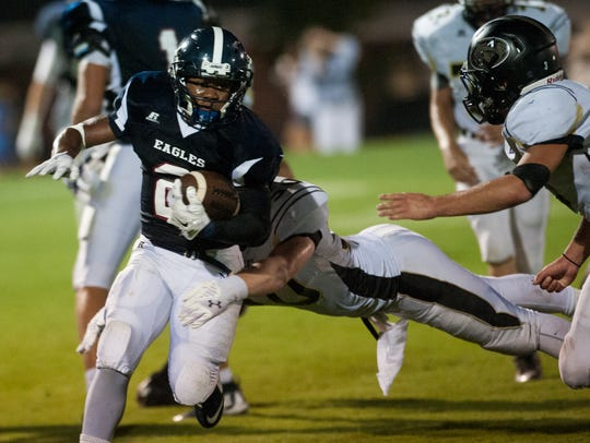 Montgomery Academy's Nelson Whyte carries against Beulah
