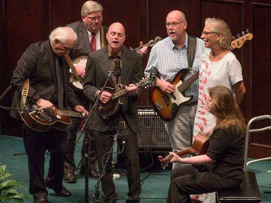 Trio Bluegrass Band performs during a memorial service