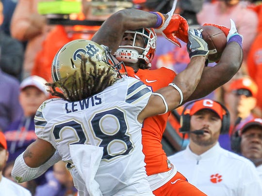 Clemson wide receiver Mike Williams (7) catches a ball near Pitt defensive back Ryan Lewis(38) during the first quarter on Saturday, November 12 at Memorial Stadium in Clemson.