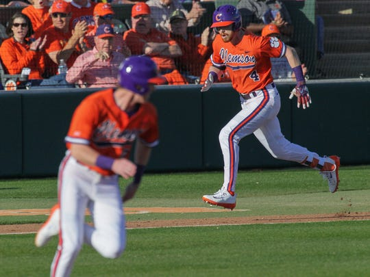 Clemson redshirt sophomore Grayson Byrd (4) single drives in Logan Davidson (8) against Wright State on Friday at Doug Kingsmore Stadium in Clemson.