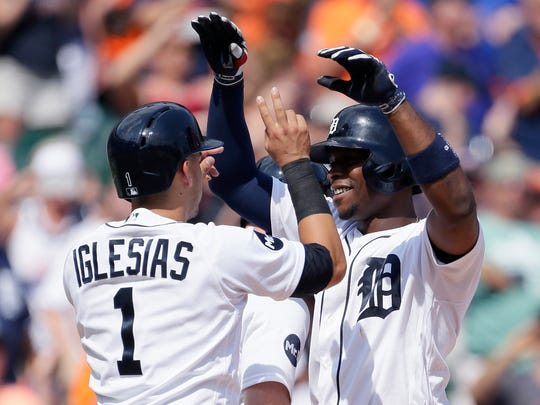 Justin Upton of the Detroit Tigers celebrates with Jose Iglesias after hitting a grand slam against the Houston Astros during the seventh inning.