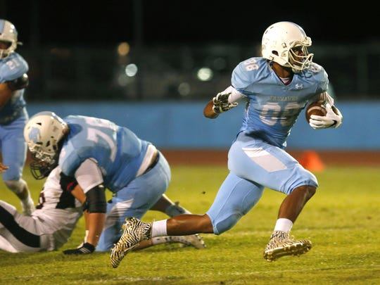 Deer Valley Dez Melton carries the ball during a high