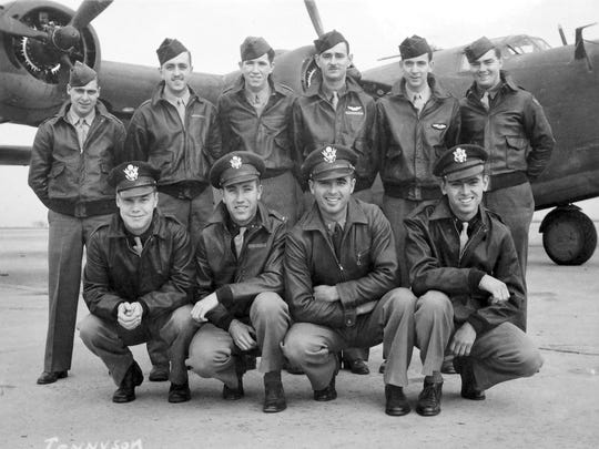 This circa 1943 Army Air Forces photo from the Kelly Family Research Project shows Staff Sgt. Eugene Darrigan, standing, second from right, and other members of the crew of the B-24 bomber  that was shot down in Hansa Bay in what is now Papua New Guinea during World War II. One of the 11 crew members is not in the photo.