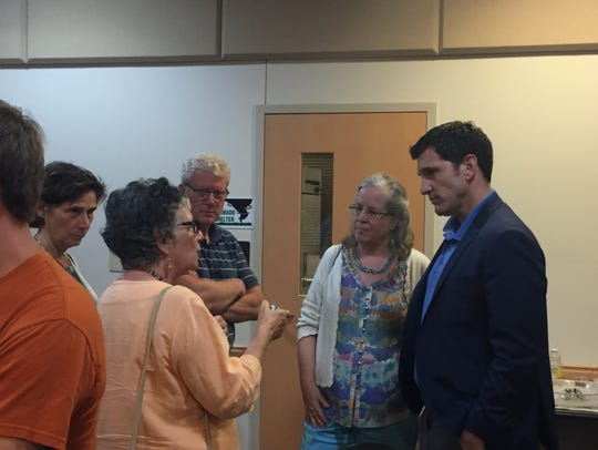 Rep. Scott Taylor, far right, speaks with constituents