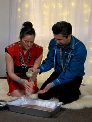 Pooya Rezai pours water over the hands of his bride,