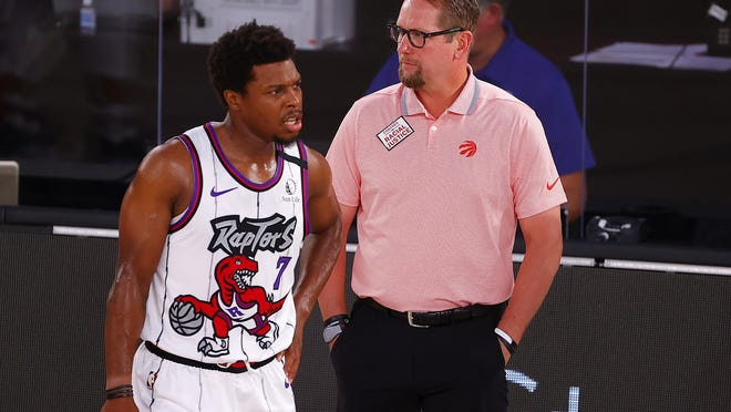 Toronto point guard Kyle Lowry, left, waited 13 season for his ultimate goal of winning an NBA title and now that he got one last year, it's not enough.