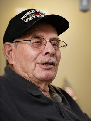 World War II veteran Gerald Olson, 89, describes his duties as a sailor  on the battleship USS Wisconsin as it bombarded the Okinawa coast shown Tuesday, Sept. 20, in his room at the St. Cloud VA Health Care System. Olson joined the military at 17.