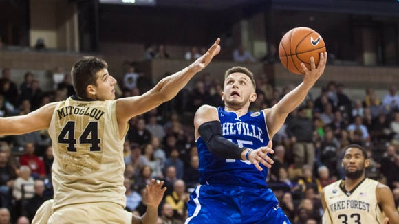 North Carolina-Asheville Bulldogs guard Andrew Rowsey goes up for a shot while defended by Wake Forest forward Konstantinos Mitoglou in November.