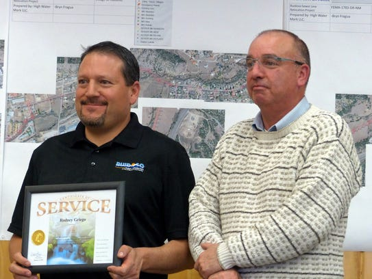 """Rodney Griego, left, director of parks and recreation, received his 25-year certificate from Ruidoso Deputy Manager Ron Sena, who said he hoped Griego would stay with his vision and creativity in pursuing recreational projects for the village. """"Although I am eligible for retirement, I don't know what I am going to do,"""" Griego said. """"I really like working for the village and applaud all of the leaders the village has. We really have a good team and that's why I really like my job so much, going to the lakes and seeing them full of water and people swimming, and having a gym.  There are so many positive things. It would be a shame to leave before I build two more fields."""""""