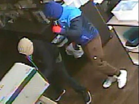 Hooded burglars break into the River's Edge Pharmacy in November.