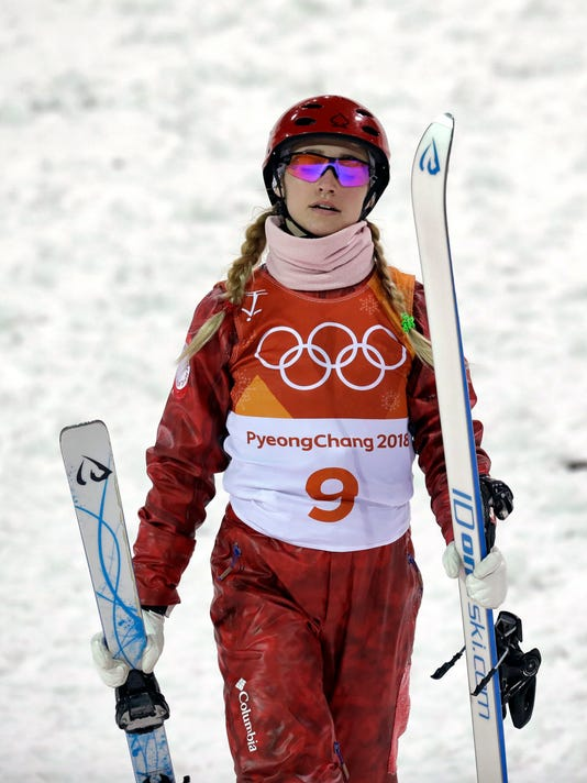 Russian athlete AlexandraOrlova carries her skis after crashing during the women's freestyle aerial final at Phoenix Snow Park at the 2018 Winter Olympics in Pyeongchang, South Korea, Friday, Feb. 16, 2018. (AP Photo/Kin Cheung)