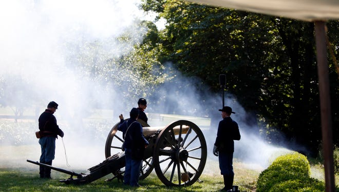 Soldiers fire cannon during Boscobel's military re-enactment day Sunday. Re-enactors demonstrated military life of historic wars from the American Revolution to World War II.