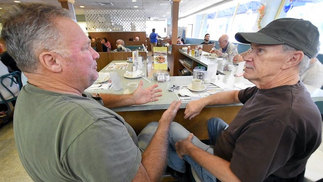 "Phil Snyder, left, of Columbia and Gregg Dubbs, who lives near Millersville, have been coming for breakfast at Hinkle's Pharmacy in Columbia for years. Snyder referring to the closing says, ""this is a pulse of the community and when you shut that down you just cut the pulse."" But word came in the last few days that a new owner will take over the restaurant."