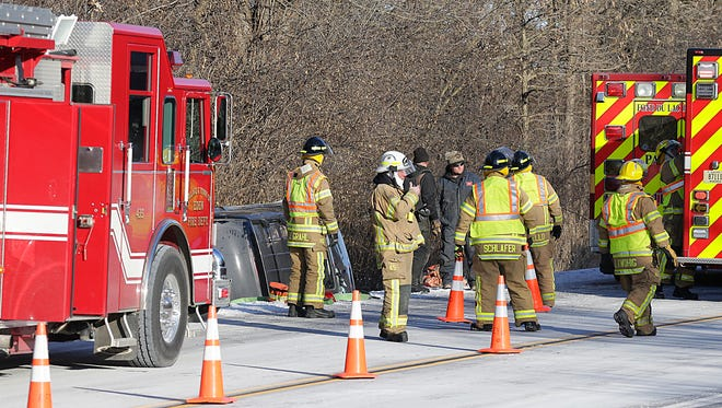 Emergency crews work the scene of a fatal one vehicle crash Thursday on Fond du Lac County K north of State 45 between Eden and Fond du Lac.
