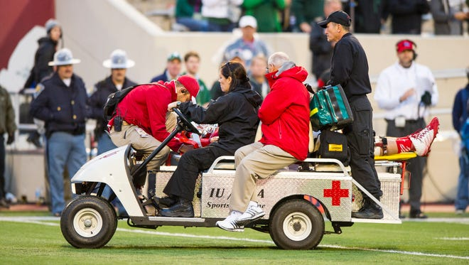 IU junior offensive tackle Jason Spriggs, seen here being carted away from Saturday's loss to Michigan State, might not miss any games, according to coach Kevin Wilson.