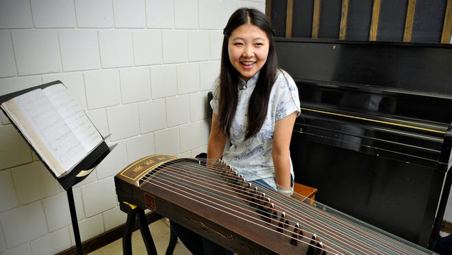 College of St. Benedict sophomore Fan Li practices the guzheng, a traditional Chinese instrument she started playing at age 7 Monday, Oct. 13. Li is an international student Datong in China's Shanxi Province.