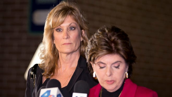 Gloria Allred, r, and her client Judy Huth in December 2014.