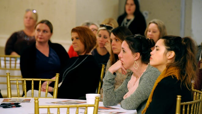 Members of the Big Country 100 Women Who Care listen to presentations from nonprofit agencies during the charitable group's quarterly meeting on Thursday, Jan. 26, 2017, at the Abilene Country Club.