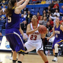 Ashley Luke of Western Illinois defends on University of South Dakota guard Raeshel Contreras during last year's Summit League Tournament at the Arena. Luke is one of the player who has a chance to turn the tournament in her team's favor.