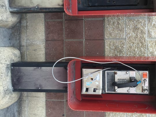 Twin phones outside Shamrock gas station