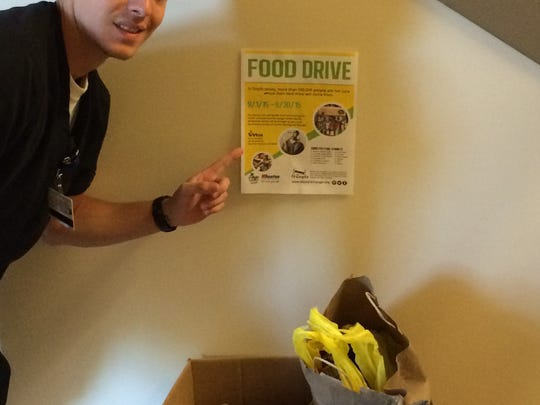 Chris Carlino, inspired by a successful food drive he spearheaded as a teen at Moorestown High School, organized another for Hunger Action Month. He's shown at Virtua Voorhees, his main drop-off location.