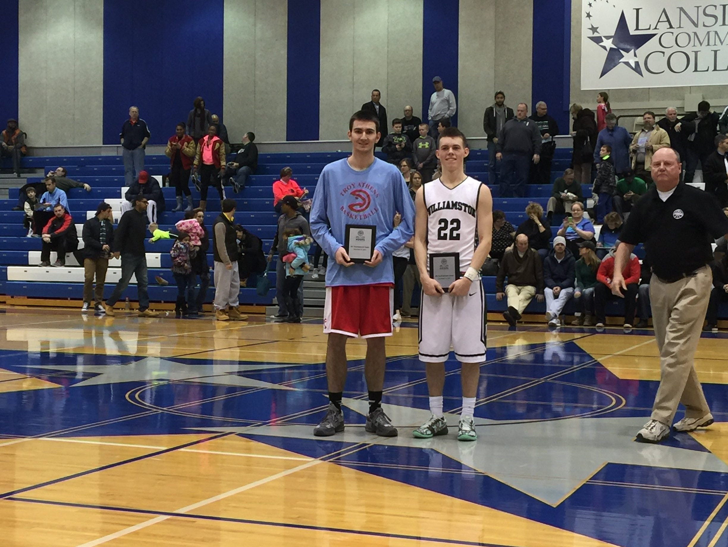 Troy Athens' Justin Koch, left, and Williamston's Riley Lewis were named to the Holiday Hoops Invitational all-tournament team Tuesday. Lewis scored 42 points in Williamston's 80-62 win.