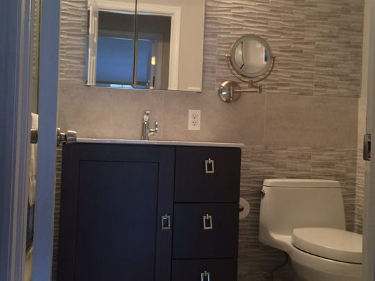 Rectangular tile and neutral colors are hot design trends for bathrooms. This is writer Marla Cimini's finished bathroom.