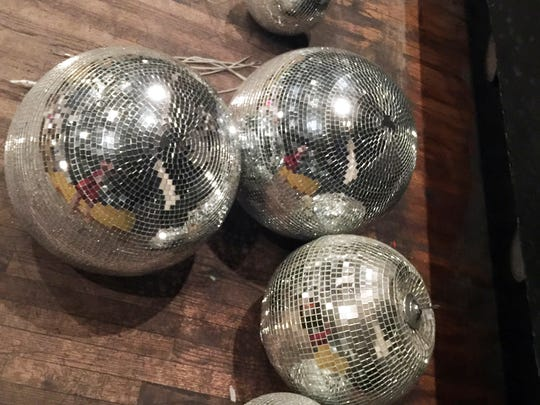 Disco balls on the dance floor.