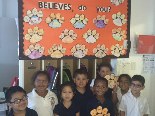 "First-grade believes, do you? As the new school year began, students at School No.2 in Linden discussed the meaning of ""believe"" and how it effects them. Then, they each created a tiger paw that states ""I believe in myself."" Pictured is Matthieu Ulep, Hailee Gonzalez-Bowles, Emily Ho, Jacob Aguilar Fuentes, William Dwight, Angelica Garcia, Asleigh Thebodeau, and Alex Cruz."