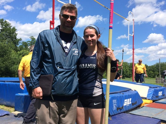 School record-holder Jackie Helm of Paramus with coach