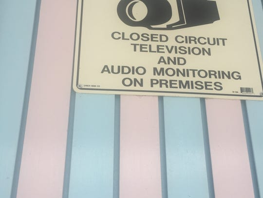 A sign at Cool Breeze Ice Cream Parlor announces monitoring