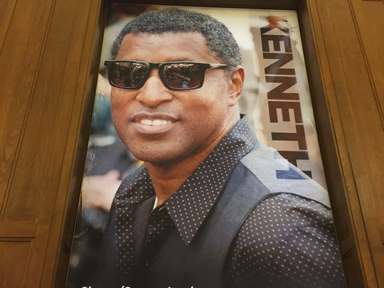 """Kenneth """"Babyface"""" Edmonds on a poster in the new Center for Black Literature and Culture in Central Library on Oct. 21, 2017"""