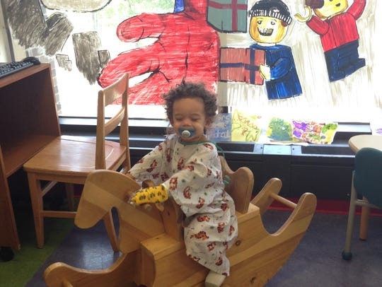 Drew, age 2, in the hospital playroom.