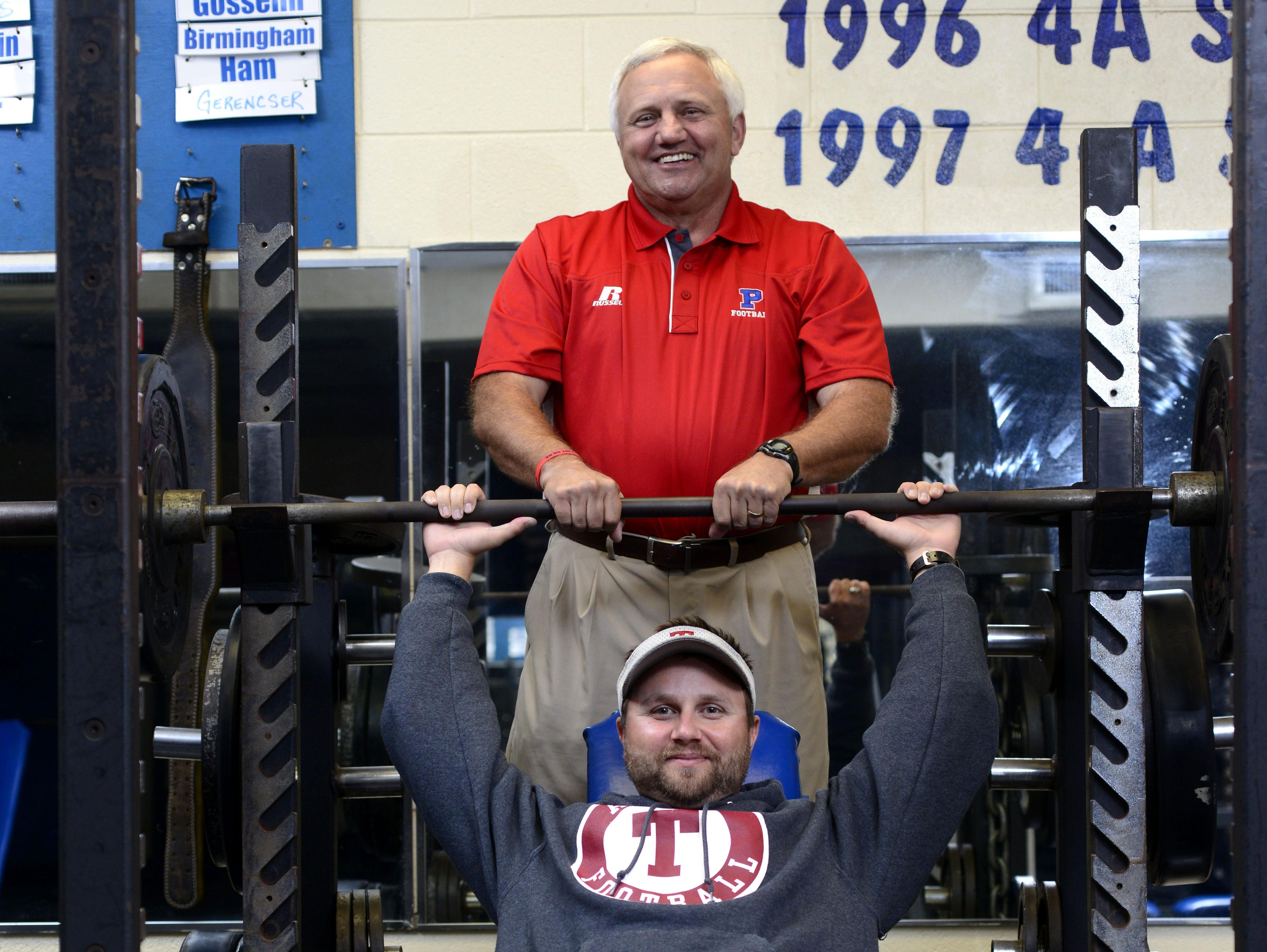 Coach Mickey Lindsey and the Pace Patriots face off against Coach Jay Lindsey and the Tate Aggies on Friday night. Though it is a rare father-son meeting on the field, both coaches agree it's not about them but about the teams.