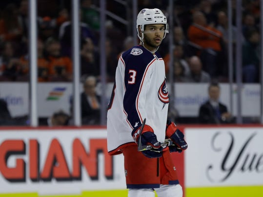 This March 15, 2018 photo shows Columbus Blue Jackets' Seth Jones skating during an NHL hockey game against the Philadelphia Flyers in Philadelphia. A tight race among contenders in the Metropolitan Division should have the top five teams battle-tested and playoff-ready. The Washington Capitals, Pittsburgh Penguins, Philadelphia Flyers, Columbus Blue Jackets and New Jersey Devils could all make it and are already in playoff mode. And the Metropolitan playoff series should be as tight as this season. (AP Photo/Matt Slocum)