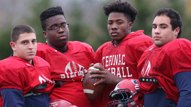 From left, Stepinac's Antonio Giannico, David Harris, Tyquell Fields, and Khaleb Celaj,will face Cardinal Hayes this Saturday night in the championship game at Fordham University. They are photographed before practice at Archbishop Stepinac High School in White Plains Nov 18, 2015.