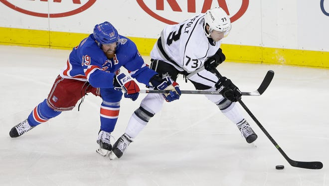 Brad Richards, left, vies for the puck against Los Angeles' Tyler Toffoli in the first period of Game 4 of the Stanley Cup Final on Wednesday.