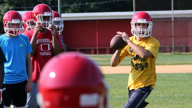Quarterback James Morina, a senior, in action during the first day of football practice at North Rockland High School, Aug. 17, 2015 in Thiells.