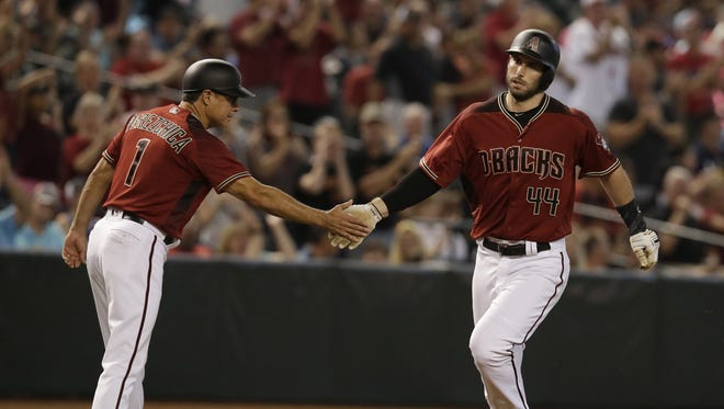 Arizona Diamondbacks first baseman Paul Goldschmidt (44) celebrates with Tony Perezchica (1) after hitting a solo home run against San Diego Padres in the fourth at Chase Field.