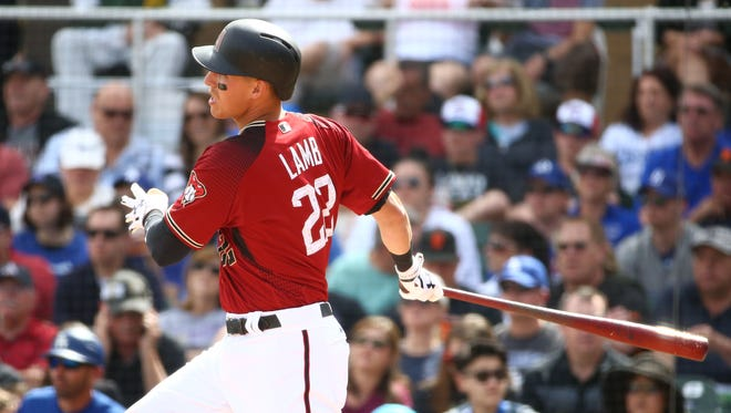 Arizona Diamondbacks Jake Lamb hits a 2-RBI double against the Los Angeles Dodgers in the 3rd inning during spring training action on Mar. 16, 2018 at Salt River Fields at Talking Stick in Scottsdale, Ariz.